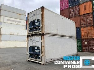 Reefer Unit Angle of Two Used 20' Refrigerated Shipping Containers Stacked at Intermodal Depot - Reefer Container Pros: Buy & Rent Refrigerated Shipping Containers