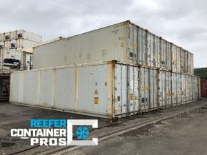 Stacks of Certified Used 40' High Cube Refrigerated Shipping Containers at Intermodal Depot - Reefer Container Pros: Buy & Rent Refrigerated Shipping Containers